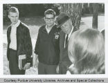 President F.L. Hovde talking with students