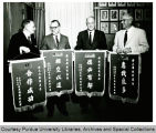 President F.L. Hovde and others with Cheng Kung banners