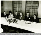 President F.L. Hovde and others seated at table