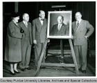 President F.L. Hovde and others with portrait