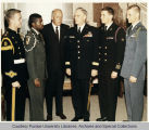 President F.L. Hovde chatting formally with military personnel