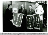 President F.L. Hovde and others with banners