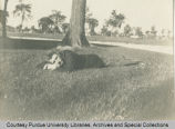 President Winthrop E. Stone laying in the grass