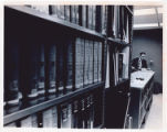 Patron using card catalog in Management and Economics Library