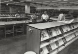 Patrons browsing in John W. Hicks Undergraduate Library