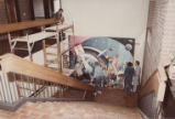 Hanging mural in staircase of John W. Hicks Undergraduate Library