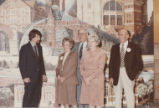Standing in front of mural that hangs in staircase of John W. Hicks Undergraduate Library