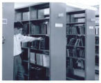Student browsing stacks in Engineering Library