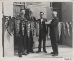 John H. Moriarty and other Purdue adiministrators hanging Big 10 flags