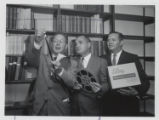 John H. Moriarty and Purdue Library staff looking at reel-to-reel film