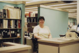 Emily Branson, HSSE library staff member, at reference desk