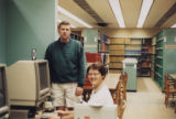 HSSE library staff at computer workstation