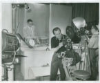 Donald J. Tandam and Roy Mills setting up video equipment in Purdue Libraries, Audio Visual center