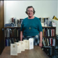 Helen Schroyer with book about Purdue seal or crest