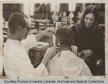 Linda K. Christian collecting hair sample from barber shop