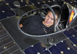 Ted Pesyna sits in solar car