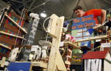Olivia Bozik shows her team's machine at Rube Goldberg Machine Competition
