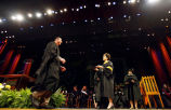 Graduate student receiving degree from Purdue President Córdova