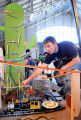 Adam Eller works on his team's machine at Rube Goldberg Machine Contest