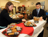 Patti Tanner and Matt Wolf set up for Sara Lee Innovation Award competition