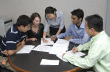 Purdue student interns discussing manufacturing principles