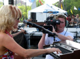 Tommy Beardmore filming at country music festival