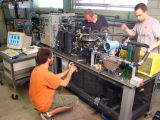 Robert Johns, Ian Bell and Vincent Lemort work in mechanical engineering lab