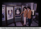 Two people looking at movie posters